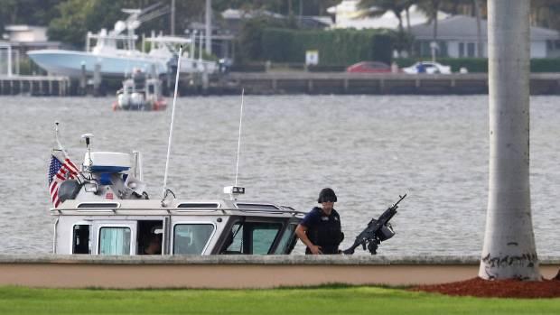 A Coast guardsman outside Trump's estate in Palm Beach.