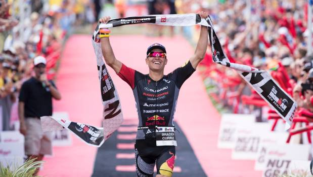 Braden Currie crosses the line to win, Ironman New Zealand