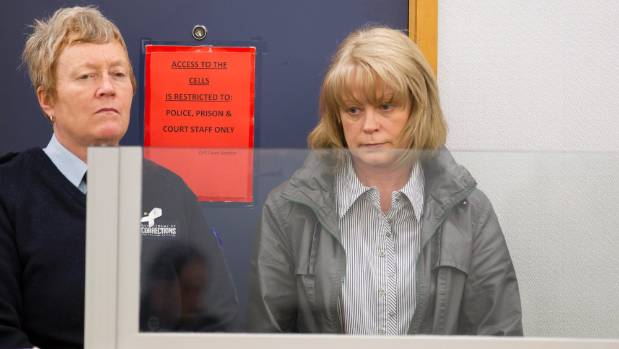 Helen Marie Kemp, right, at her sentencing in September 2014.