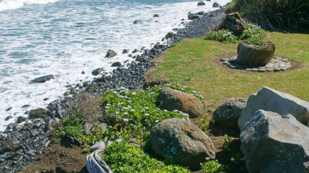 There were once steps leading down to the sea, but they were swept away, along with some of the boulders and driftwood.