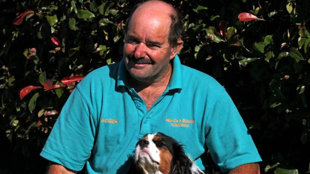 Tokoroa's Roger Drower with his disability dog Harper.