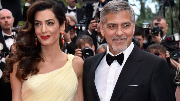 A hot pair of midsters: Amal and George Clooney.