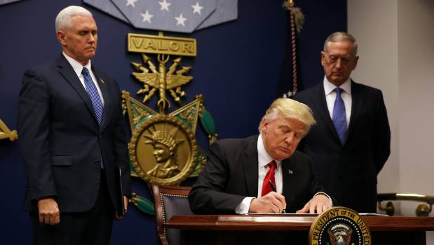 US President Donald Trump signs an executive order for a travel ban, at the Pentagon in January.