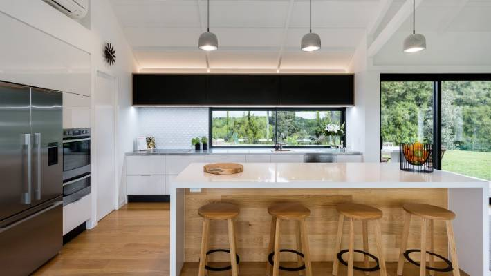 In This Large Open Plan Living Area The Kitchen Runs Parallel To