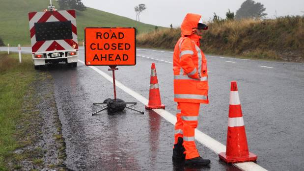 Motorists get turned back at a cordon between Waihi and Whangamata as contractors work to clear slips.