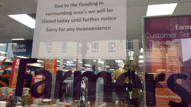 Shops and banks, including the Westpac and Kiwibank, are closed due to flooding after heavy rain overnight and into ...