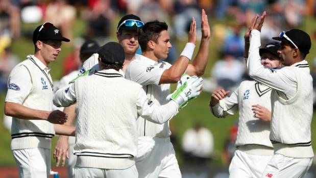 Trent Boult celebrates taking the wicket of South Africa's Stephen Cook.