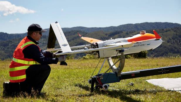 Flight crew member Maurice Gonella from Drone Technologies prepares the drone aircraft for launch during a trial flight ...