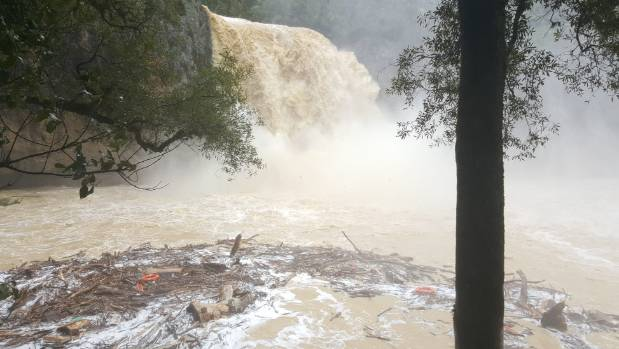 The unprecedented rainfall was summed by these images of the falls in Auckland's Hunua Ranges.