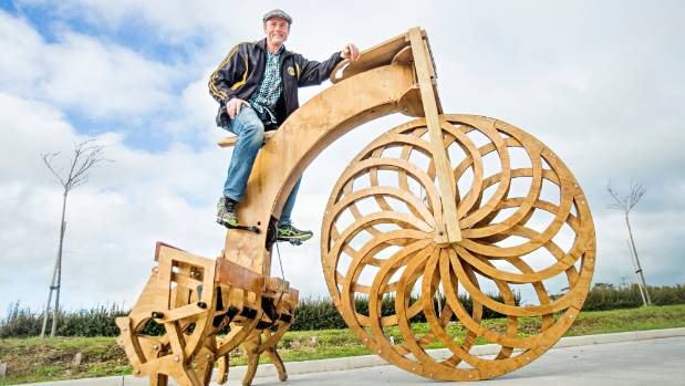 "Hunger is also known for his amazing creations, like the wooden ""spider bike""."