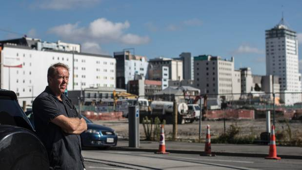 "Urban designer Garth Falconer in front of what he calls the ""Great Wall of Christchurch"" dividing east and west."