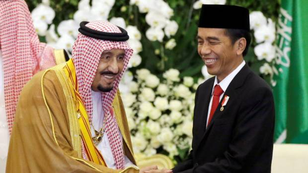 Saudi King Salman, left, shakes hands with Indonesian President Joko Widodo during their meeting at the presidential ...