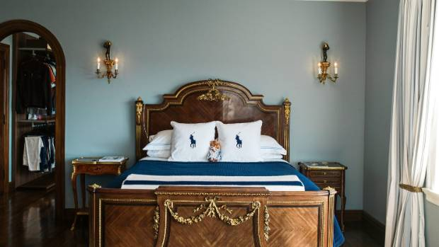The bed in the master suite was made by Paul Sormani; the bedlinen and curtains are by Ralph Lauren; ceiling cornices ...