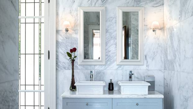 The master bathroom has floor to ceiling Carrara marble.