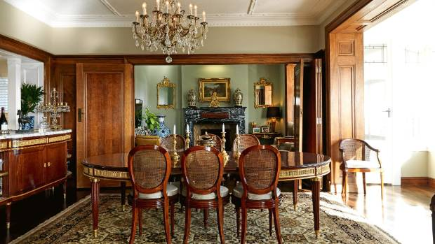 The 19th century French mahogany dining set and chiffonier in real estate agent Michael Boulgaris' Remuera home are by ...