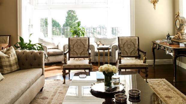The two French 19th century chairs in the living room are part of a set placed throughout the house; the sofa at left ...