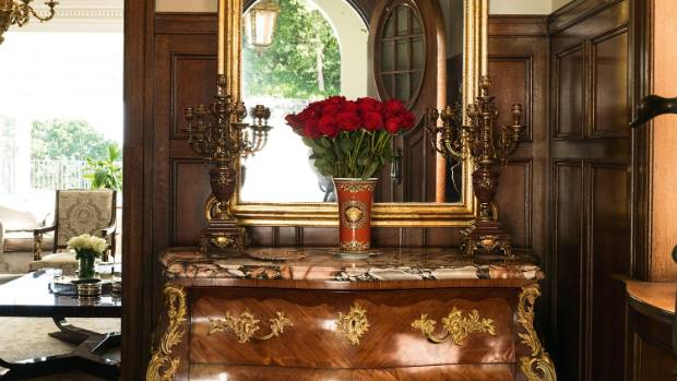 The commode was from Barry Thomas Antiques, which is no longer in operation, and the gold leaf and wood mirror is from ...