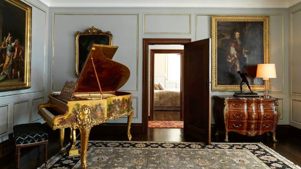 A hand-painted and gilded 19th century Pleyel piano sits in the ballroom.