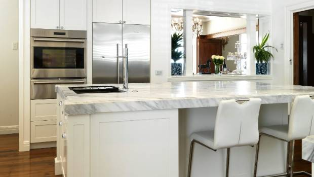 """Six men were needed to carry the kitchen's Carrara marble benchtop: """"I wanted it in one piece as I didn't want a join,"""" ..."""