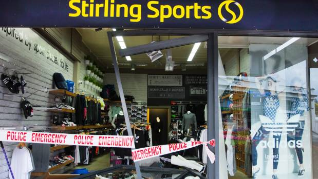 Smashed glass lay scattered on the ground after a ram-raid at Stirling Sports Cambridge on Friday.