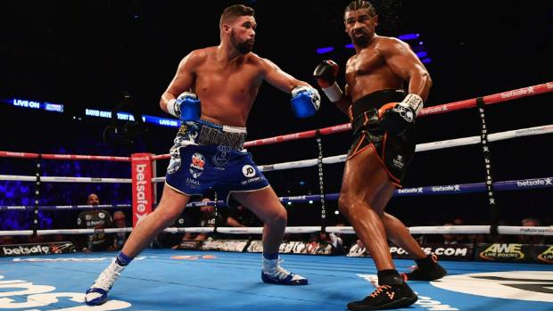 Tony Bellew rocks David Haye during their rugged all-England fight in London.