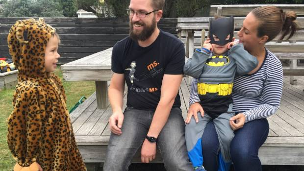 "Thomas, left, is looking forward to doctors ""fixing"" his dad, and Lachlan prefers to leave his Batman mask on for photos."