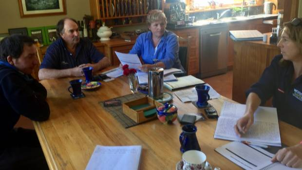 Anne and Philip with farm worker  Greg Macfarlane sit around the kitchen table with Worksafe farm inspector Christine ...