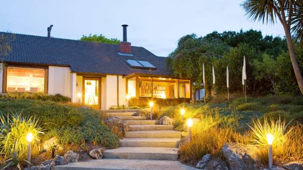Outdoor lighting glows on the steps leading up to the front entrance of a Hawke?s Bay home.