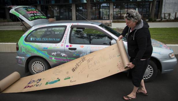 Bung the Bore spokeswoman Jen Branje stopped outside ECan while driving a petition from Invercargill to Wellington, ...