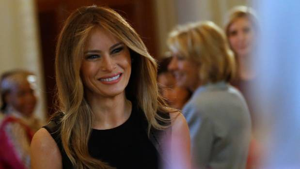 Melania Trump arrives to join her guests for an International Women's Day luncheon in the State Dining Room at the White ...