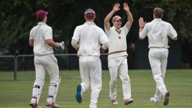 Burnside West Christchurch University celebrate a wicket in their two-day victory over Old Boys Collegians on Saturday.