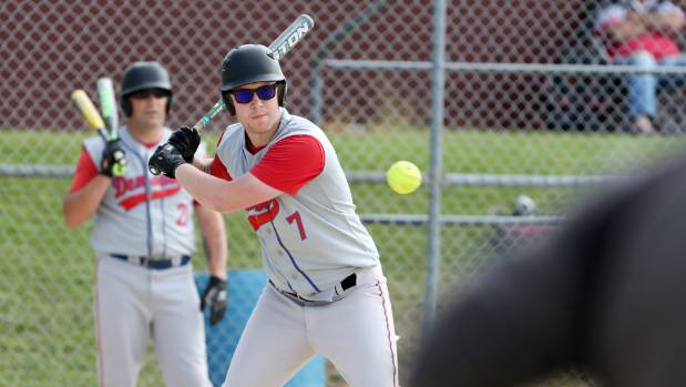 Demons Red player Daniel Karsten batting against the Panthers in Southland's Major League softball competition.