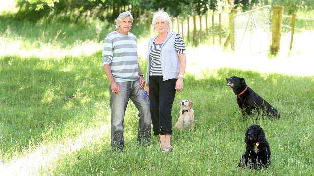Murray Ball with wife Pam at his Gisborne home and his three dogs.