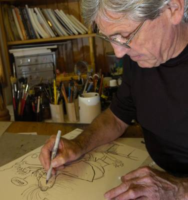 Ball works on one of his cartoons.