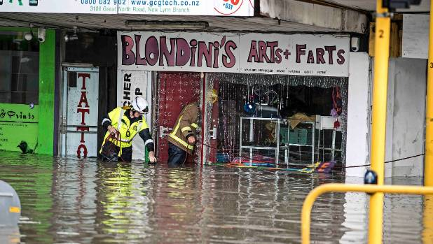 Emergency services were called to flooded homes and businesses in New Lynn.