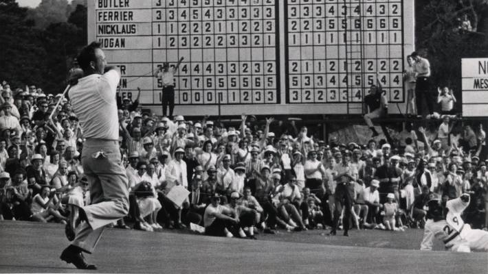Arnold Palmer reacts to his winning putt on the 18th green during the 1964  Masters Tournament 4c73926bc