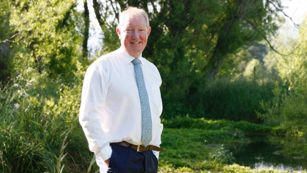 Bovine latrine or national treasure? Environment Minister Nick Smith poses beside a creek near Nelson.