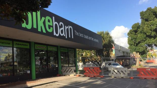 Bike Barn in New Lynn was closed as staff clean up after the damage caused by Tasman Tempest.