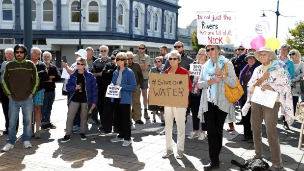 Protesters listen to speeches during a water quality rally outside Timaru District Council.