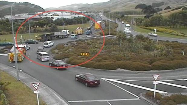 An overturned trailer carrying a digger at Plimmerton is causing traffic delays.