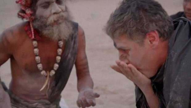 An Aghori encourages CNN's Reza Aslan to eat a piece of human brain during an episode of Believers.