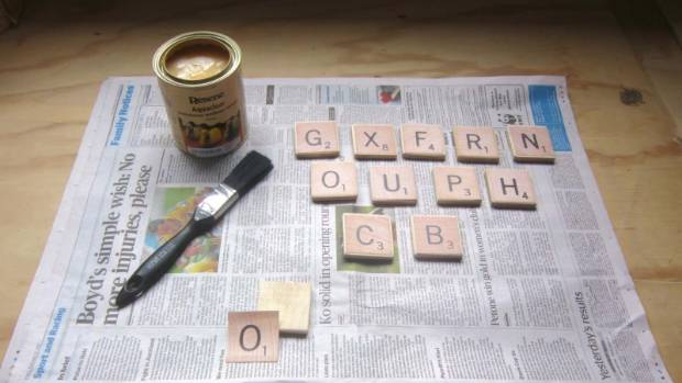 Step 4: Mark 50mm x 50mm squares on the 6mm ply and cut out the letter tiles. Print and cut out the letters, then glue ...
