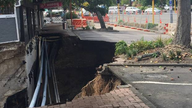 The scouring of the land after a footpath collapsed in New Lynn, Auckland after the Tasman Tempest on March 12.