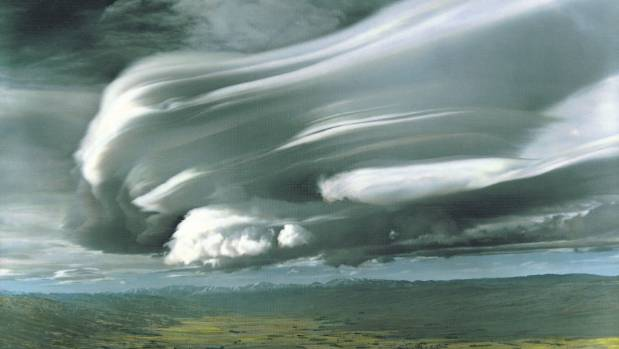 The cloud formation known as the Taieri Pet hangs over the Otago village of Middlemarch; the threats of a poison pen ...