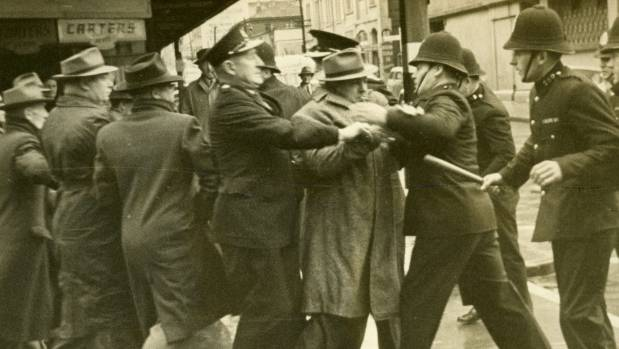 Police confront union marchers in 1951.