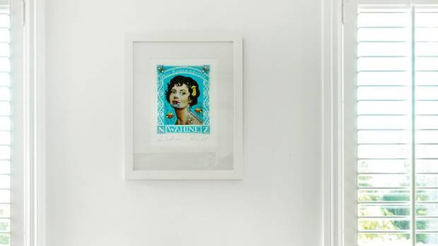 Wahine by Lester Hall above a side table in the guest bedroom.