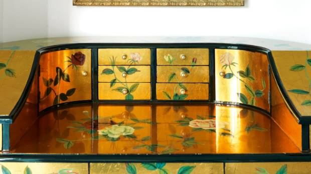 "The lacquered desk came from a junk shop in Singapore: ""It was covered in dust and a bit chipped. I just touched it up ..."