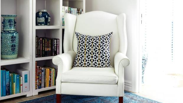 An old wingback chair belonging to Bridget's father was given a new life in white leather.