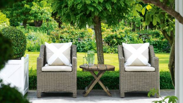 A tranquil spot under the wisteria on the front deck; the outdoor chairs came from Artwood in Christchurch.
