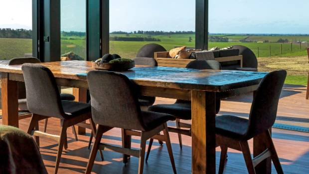 The view from the dining table sweeps from the Southern Alps to the ocean.